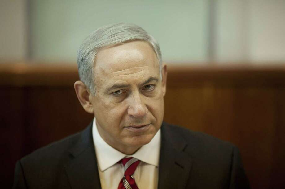 JERUSALEM, ISRAEL - OCTOBER 13: Israeli Prime Minister Benjamin Netanyahu holds the weekly cabinet meeting on October 13, 2013 in Jerusalem, Israel. (Photo by Ariel Schalit-Pool/Getty Images) ORG XMIT: 183599459 Photo: Pool / 2013 Getty Images