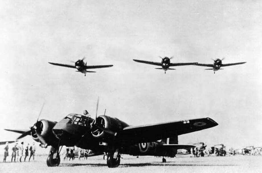 Three U.S. Brewster Buffalo fighters fly over a British Bristol Blenheim bomber at an airfield in Singapore before the territory was taken by the Japanese in 1942. Photo: Three Lions, Getty Images / Hulton Archive