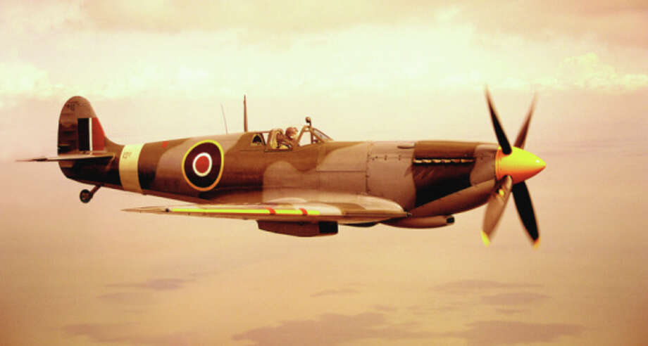 A Spitfire aircraft in flight. Photo: Michael Dunning, Getty Images / (c) Michael Dunning