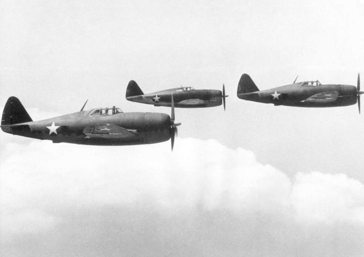Three Republic P-47 Thunderbolt fighter planes in flight, May 10, 1943.