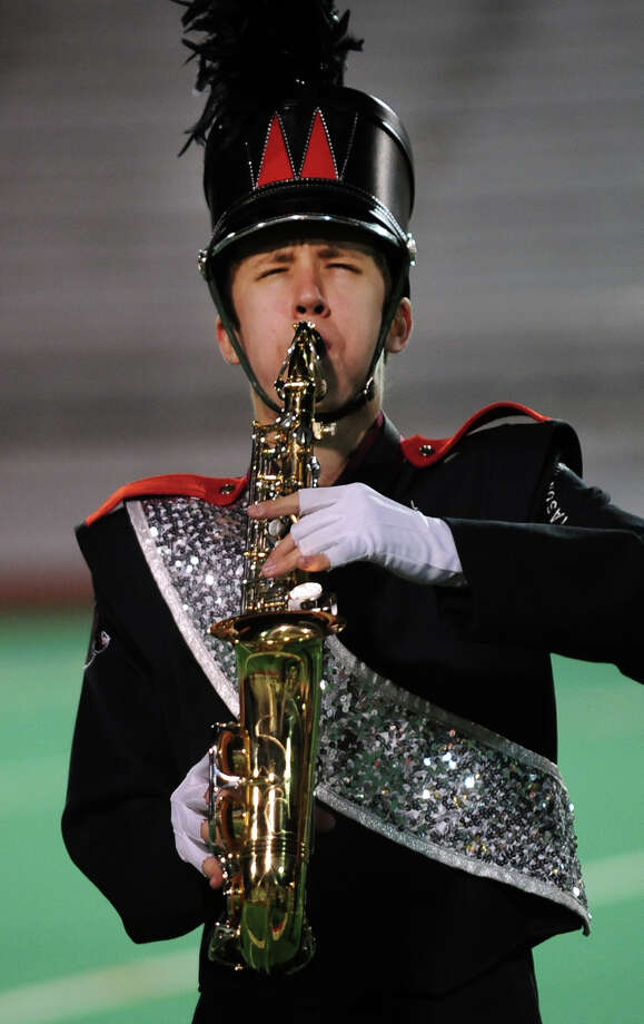 Drew Pothanszky, of Masuk High School in Monroe, plays the saxaphone during the Musical Arts Conference (MAC) Fall Marching Band Championships at Central High School's Kennedy Stadium in Bridgeport, Conn. on Saturday November 9, 2013.The competition features marching bands from all over Connecticut including several from Fairfield County. Photo: Christian Abraham / Connecticut Post