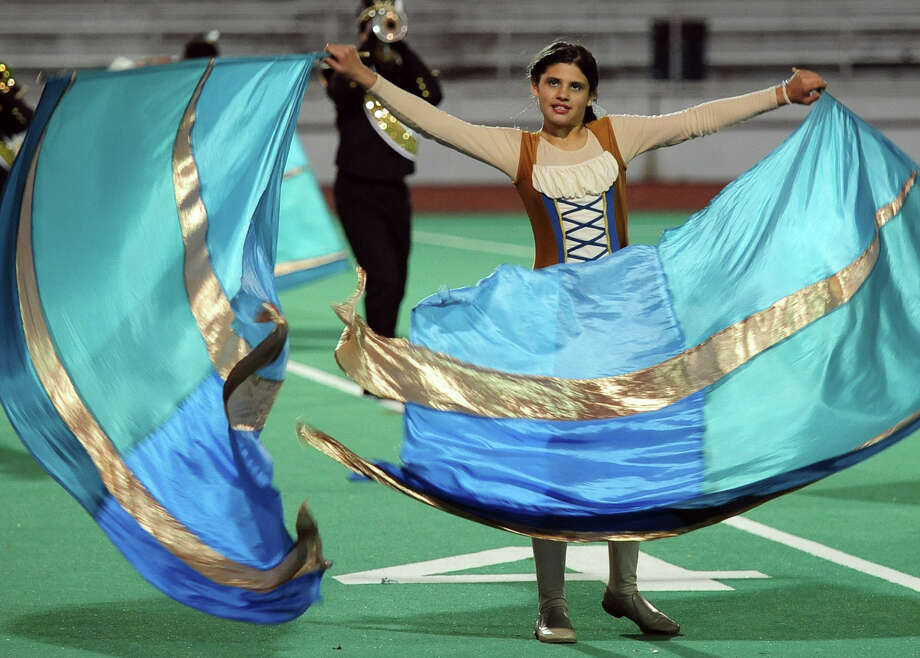Lilah Khan, with Jonathan Law high School, performs with the color guard during the Musical Arts Conference (MAC) Fall Marching Band Championships at Central High School's Kennedy Stadium in Bridgeport, Conn. on Saturday November 9, 2013.The competition features marching bands from all over Connecticut including several from Fairfield County. Photo: Christian Abraham / Connecticut Post