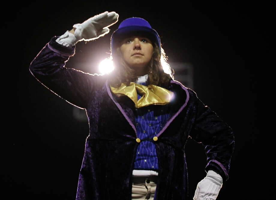 Drum Major Maryann Victoria, with Shelton High School, salutes the audience during the Musical Arts Conference (MAC) Fall Marching Band Championships at Central High School's Kennedy Stadium in Bridgeport, Conn. on Saturday November 9, 2013.The competition features marching bands from all over Connecticut including several from Fairfield County. Photo: Christian Abraham / Connecticut Post