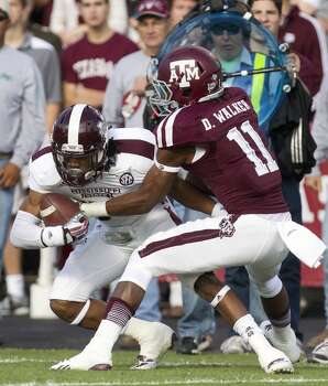 Texas A&M Aggies wide receiver Derel Walker drags down Mississippi State Bulldogs defensive back Nickoe Whitley after Whitley intercepted a pass intended for Walker during the first quarter of an NCAA College Football game at Kyle Field Saturday, Nov. 9, 2013, in College Station. (Cody Duty / Houston Chronicle) Photo: Cody Duty, Houston Chronicle