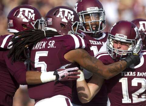 Aggies celebrate after they blocked a punt from Bulldogs kicker Devon Bell. Photo: Cody Duty, Houston Chronicle