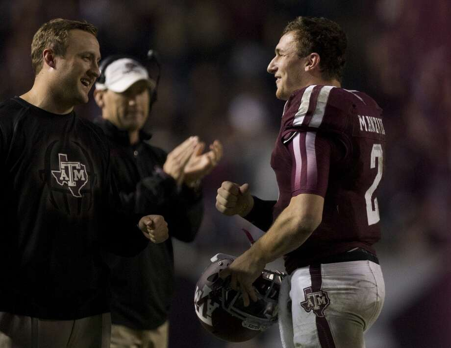 Aggies quarterback coach greets quarterback Johnny Manziel after he threw a fourth quarter touchdown. Photo: Cody Duty, Houston Chronicle