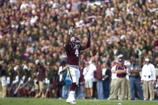 Aggies defensive back Toney Hurd Jr. encourages the crowd. Photo: Cody Duty, Houston Chronicle
