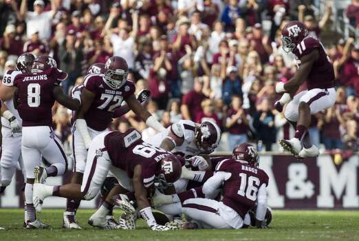 The Aggies celebrate a fourth-down stop against the Bulldogs. Photo: Cody Duty, Houston Chronicle