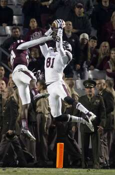 Aggies defensive back Deshazor Everett can't break up a touchdown pass to Mississippi State wide receiver De'Runnya Wilson. Photo: Cody Duty, Houston Chronicle