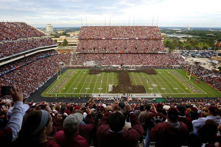 Fans watch and take photos as the Aggie Corps marches on the field. Photo: Cody Duty, Houston Chronicle