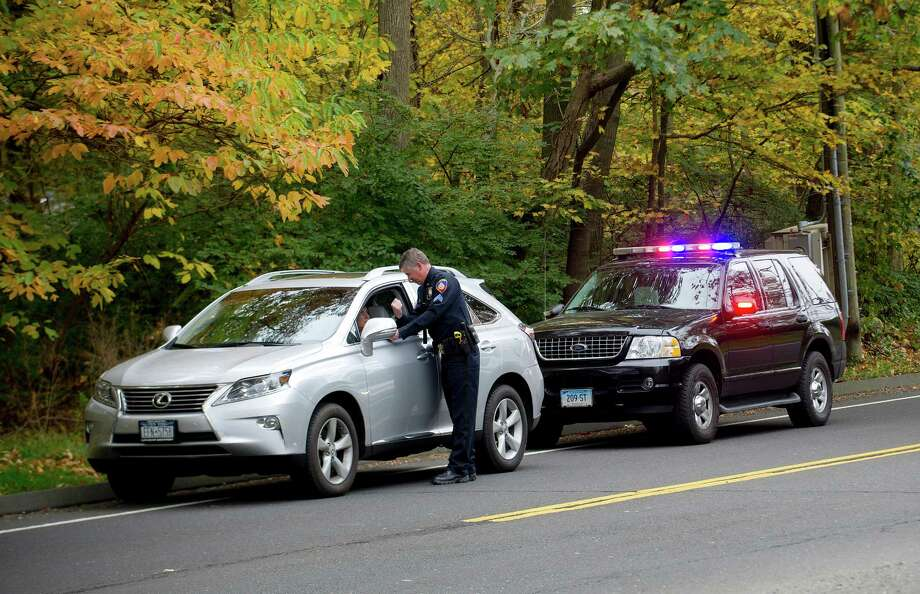 Stamford police Sgt. Andrew Gallagher stops a driver for speeding on High Ridge Road on Oct. 23. Photo: Lindsay Perry / Stamford Advocate