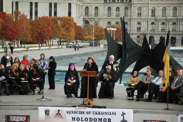 Amsterdam Mayor Ann Thane speaks. On Saturday , November 2, 2013 a commemoration of the 80th Anniversary of the Holodomor Famine-Genocide of Ukrainians was held at the Empire State Plaza in Albany, New York. The event was organized by a committee of local Ukrainian Americans with two goals: to commemorate and to educate. To commemorate the up to 10 million victims of Stalin?s deliberate artificial terror famine of 1932-33 who died in silence, victims of Stalin?s programs of collectivization and Russification;  and to educate the public at large of this heinous crime by making its teaching a mandatory part of the New York State Curriculum.