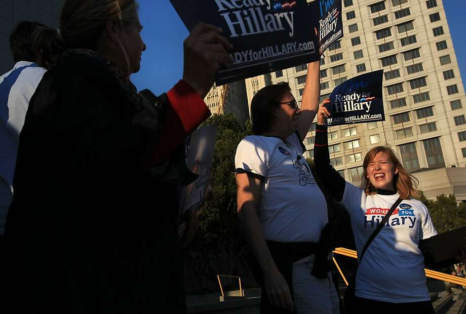 Emma Gibbens (right) joins other supporters of Hillary Rodham Clinton, including Pamela DiGiovanni (left) and Mark Murphy, outside Moscone Center, where Clinton was speaking. Photo: Leah Millis, The Chronicle
