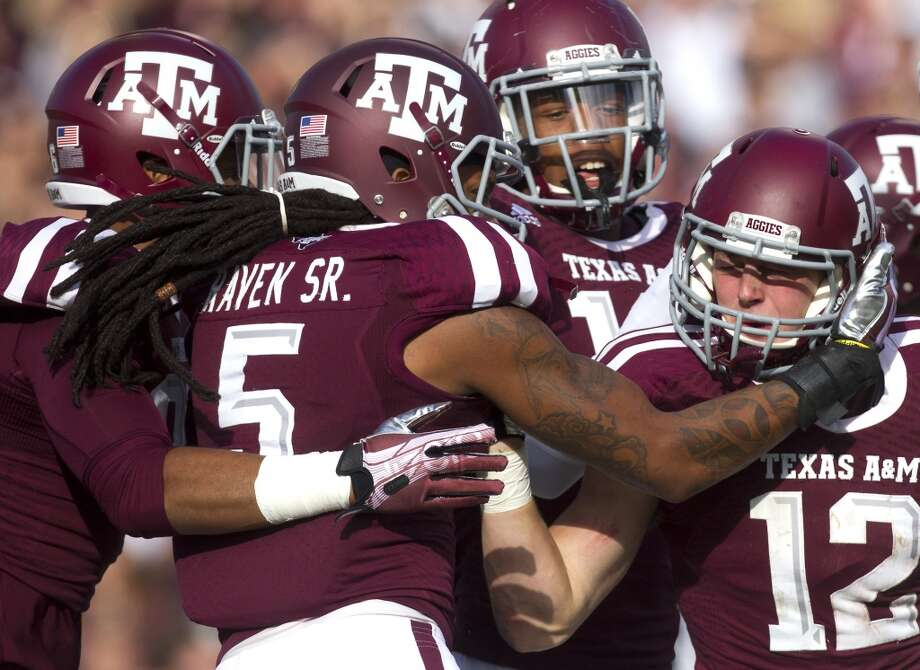 The Texas A&M Aggies celebrate after they blocked a punt from Mississippi State Bulldogs kicker Devon Bell of an NCAA College Football game at Kyle Field Saturday, Nov. 9, 2013, in College Station. (Cody Duty / Houston Chronicle) Photo: Cody Duty, Houston Chronicle