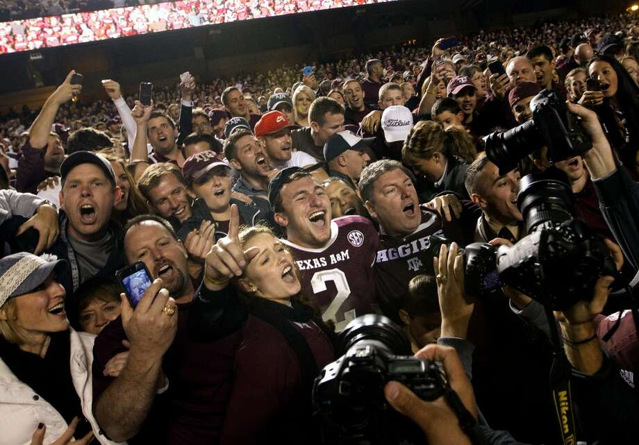 Texas A&M Aggies quarterback Johnny Manziel, 2, sings with fans after beating the Mississippi State Bulldogs 51-41 in an NCAA College Football game at Kyle Field Saturday, Nov. 9, 2013, in College Station. (Cody Duty / Houston Chronicle) Photo: Cody Duty, Houston Chronicle