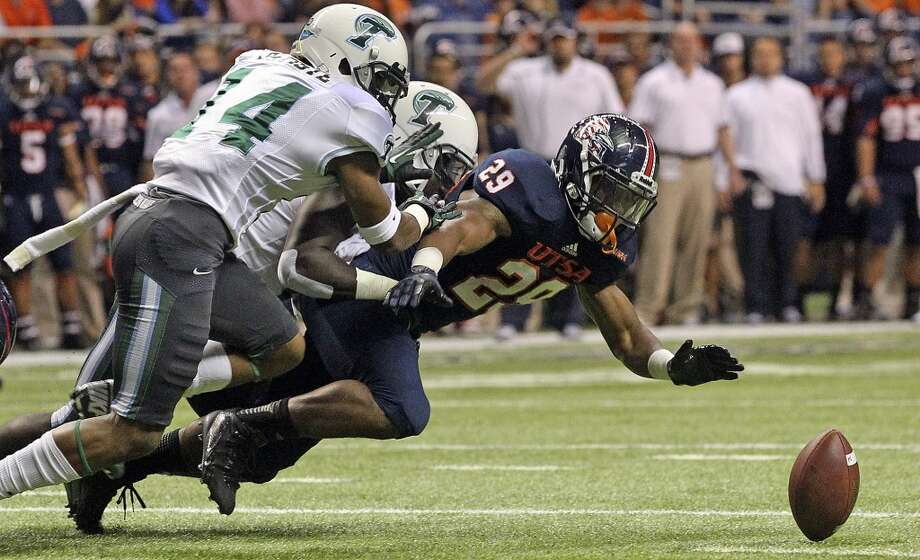 Raodrunner running back Jarveon Williams fumbles the ball close to the goal line in the first half as UTSA  hosts Tulane at the Alamodome on November 10, 2013.