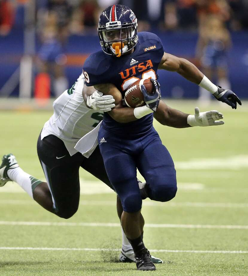 Roadrunner  running back Jarveon Williams makes yardage in the first quarter as UTSA  hosts Tulane at the Alamodome on November 10, 2013.
