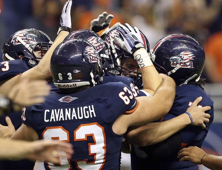 Teammates congratulated place kicker Sean Ianno who kicked the winning goal as UTSA  beats Tulane 10-7 at the Alamodome on November 10, 2013.