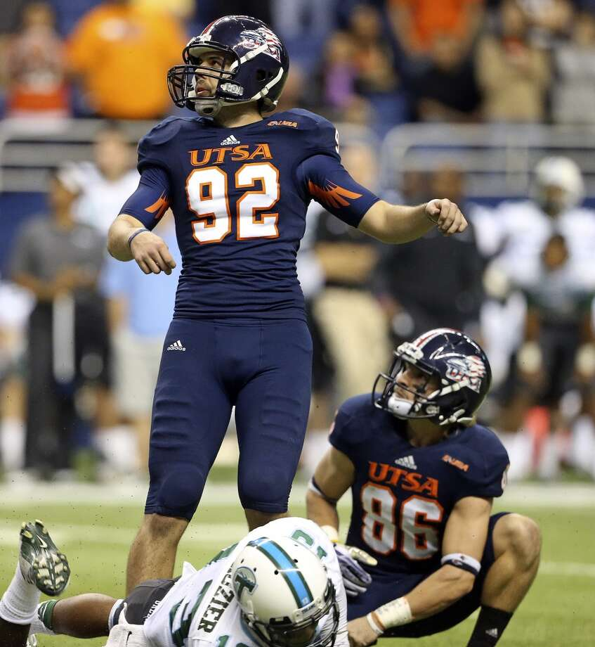 Sean Ianno watches his kick go through the uprights to prove the winning score as holder Seth Grubb holds as UTSA  hosts Tulane at the Alamodome on November 10, 2013.