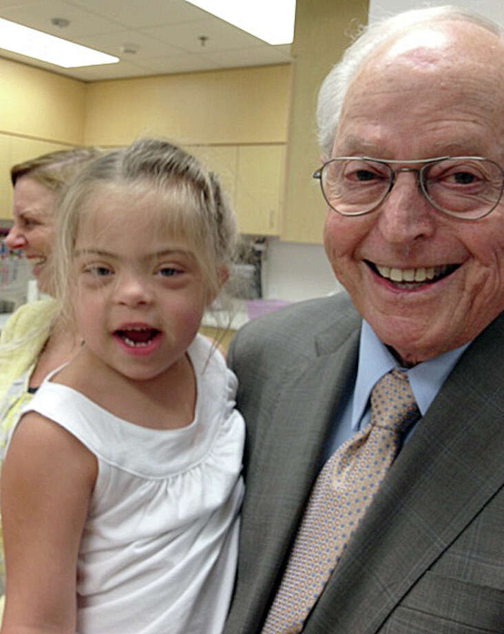 John Duncan with Leila Tatum, 4, who is in her third year at The Brenda and John Duncan Rise School of Houston. The Rise School opened in January 2000 and today serves nearly a hundred students in a bright, airy building near the Texas Medical Center. It's Houston's first and only school dedicated to the early education of infants, toddlers and pre-school children with learning disabilities. Photo: Joe Holley, Houston Chronicle / Houston Chronicle
