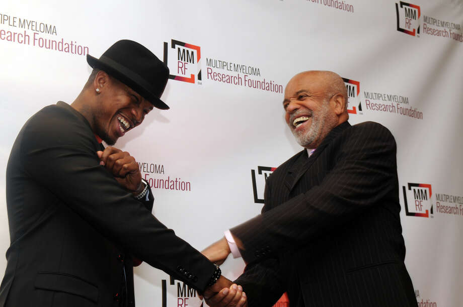 Ne-yo and Berry Gordy share a laugh at the Multiple Myeloma Research Foundation's 17th Annual Fall Gala which recognized Motown Founder Berry Gordy and featured a performance by Grammy winning artist Ne-Yo at the Greenwich Hyatt in Greenwich, Conn., Nov. 9, 2013. The event raised more than $2 million dollars for research. Photo: Keelin Daly / Stamford Advocate Freelance