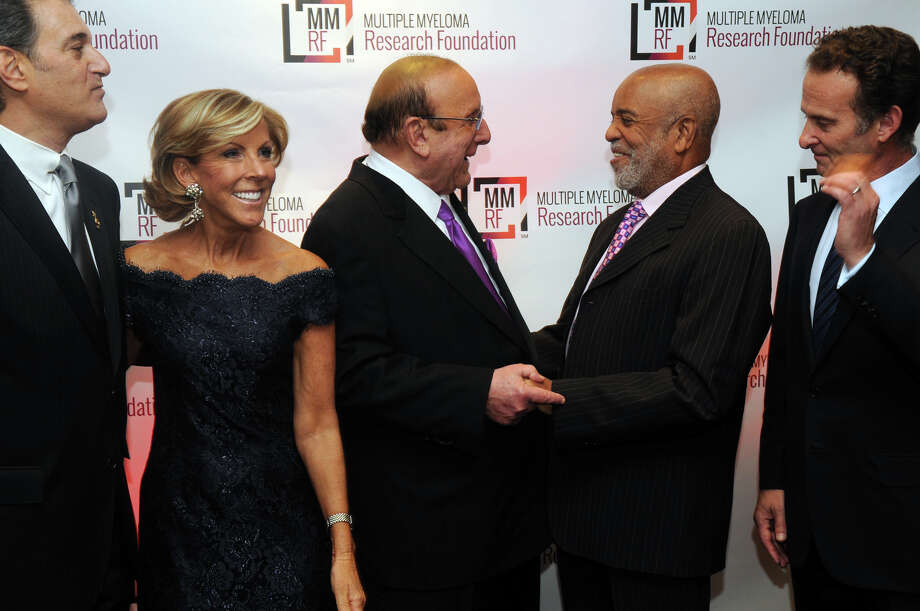 Music industry legends Clive Davis and Berry Gordy chat while waiting for a photo op with Michael Reinert, left, an MMRF board member, Kathy Giusti, founder and CEO of MMRF, and Charles Goldstuck, right, president and CEO of TouchTunes, at the start of the Multiple Myeloma Research Foundation's 17th Annual Fall Gala. The event recognized Motown Founder Berry Gordy and featured a performance by Grammy winning artist Ne-Yo at the Greenwich Hyatt in Greenwich, Conn., Nov. 9, 2013. The event raised more than $2 million dollars for research. Photo: Keelin Daly / Stamford Advocate Freelance