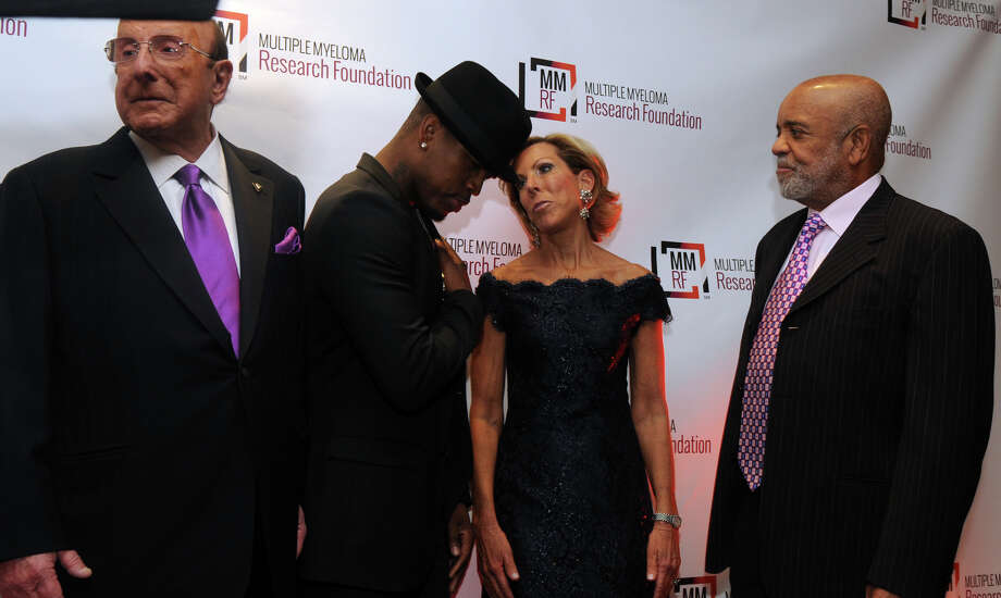 Music industry legends Clive Davis and Berry Gordy flank Grammy winning artist Ne-Yo and Kathy Giusti, founder and CEO of MMRF, at the start of the Multiple Myeloma Research Foundation's 17th Annual Fall Gala. The event recognized Motown Founder Berry Gordy and featured a performance by Grammy winning artist Ne-Yo at the Greenwich Hyatt in Greenwich, Conn., Nov. 9, 2013. The event raised more than $2 million dollars for research. Photo: Keelin Daly / Stamford Advocate Freelance