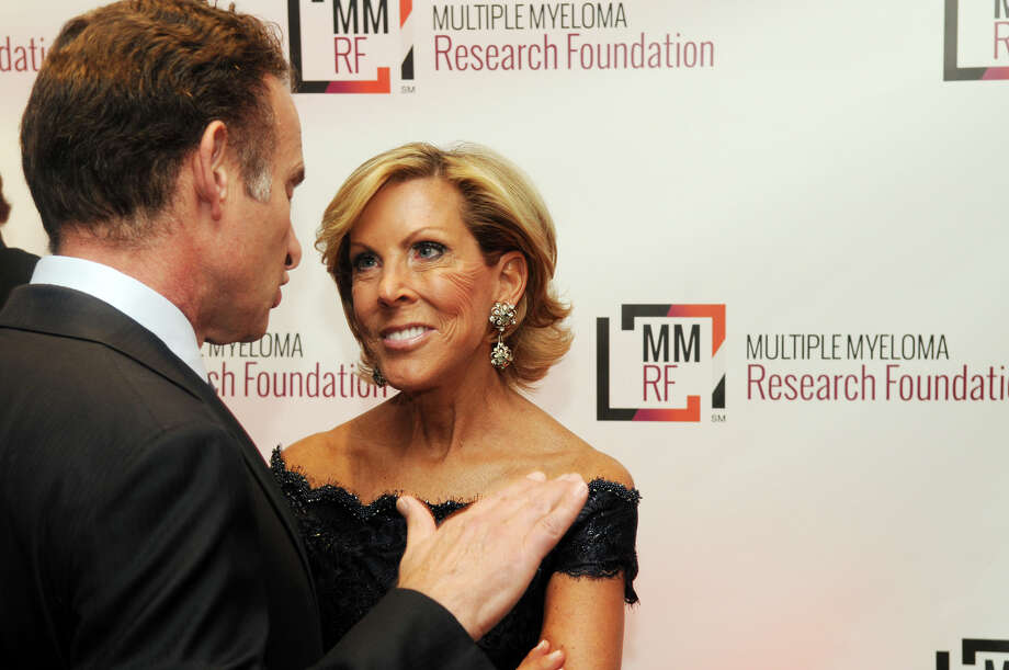 Kathy Giusti, founder and CEO of MMRF, speaks with Charles Goldstuck, president and CEO of TouchTunes at the start of the Multiple Myeloma Research Foundation's 17th Annual Fall Gala. The event recognized Motown Founder Berry Gordy and featured a performance by Grammy winning artist Ne-Yo at the Greenwich Hyatt in Greenwich, Conn., Nov. 9, 2013. The event raised more than $2 million dollars for research. Photo: Keelin Daly / Stamford Advocate Freelance