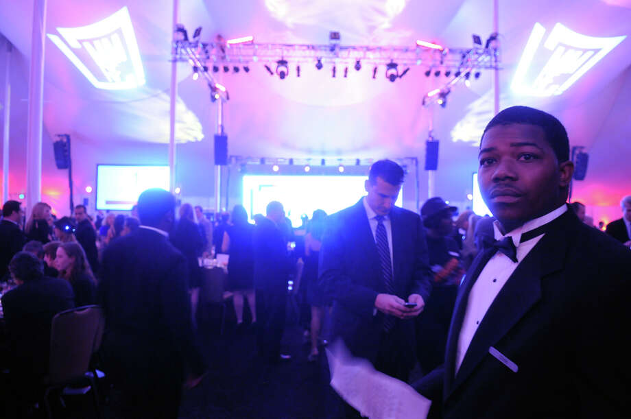 An usher waits to seat guests as the Multiple Myeloma Research Foundation's 17th Annual Fall Gala recognized Motown Founder Berry Gordy and featured a performance by Grammy winning artist Ne-Yo at the Greenwich Hyatt in Greenwich, Conn., Nov. 9, 2013. The event raised more than $2 million dollars for research. Photo: Keelin Daly / Stamford Advocate Freelance