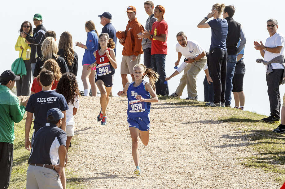 Paige Hofstad of New Braunfels runs ahead of Manvel's Julia Heymach in the Class 5A girls race at Old Settlers Park on Saturday. Hofstad beat Heymach by nearly 13 seconds. Photo: Photos By Marvin Pfeiffer / San Antonio Express-News