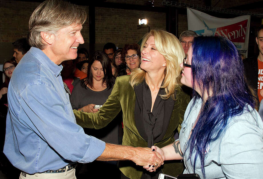 Texas State Sen. Wendy Davis, center, introduces her boyfriend, former Austin mayor Will Wynn to supporter Kristen Henderson. Davis signed the papers that make her candidacy for governor official on Saturday, Nov. 9, 2013. With a crowd of supporters crammed into the offices of internet company uShip in downtown Austin, Davis begins her campaign in earnest against her Republican rival, Attorney General Greg Abbott, who also signed his documents on Saturday. Photo: Alberto Martínez, Austin American-Statesman /  - Austin American-Statesman
