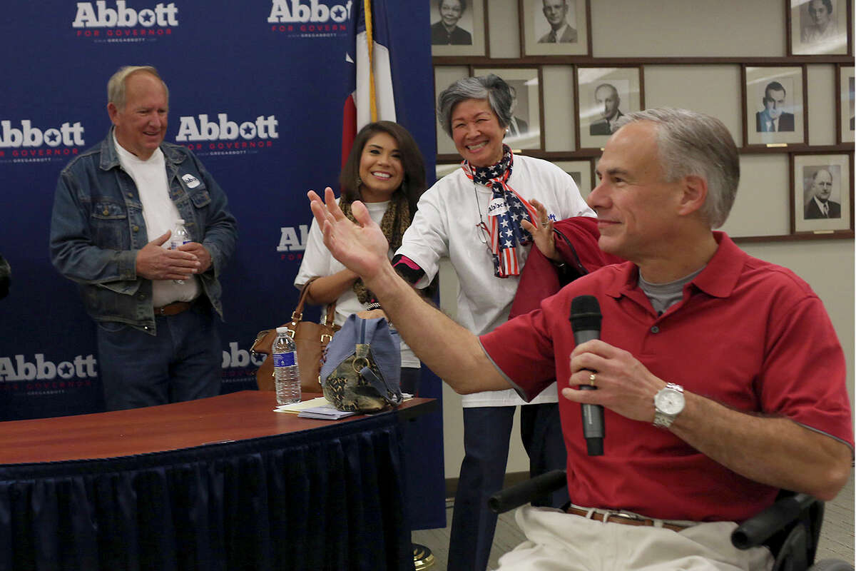 Texas Attorney General Greg Abbott greets supporters gathered to block walk to campaign for him before he officially files paperwork for his candidacy for governor of Texas at the Texas Republican Party headquarters in Austin on Saturday, November 9, 2013.