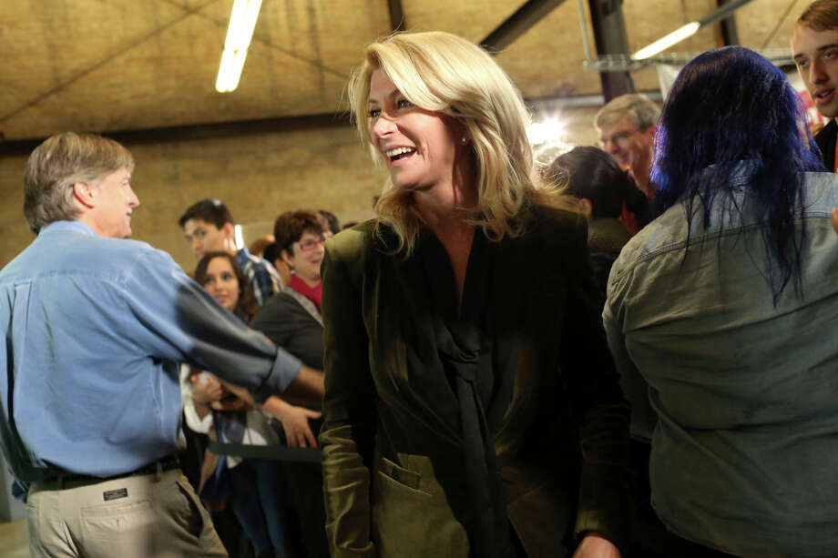 State Senator Wendy Davis greets supporters after officially filing paperwork for her candidacy for governor of Texas at uShip in Austin on Saturday, November 9, 2013. Photo: Lisa Krantz, San Antonio Express-News / San Antonio Express-News