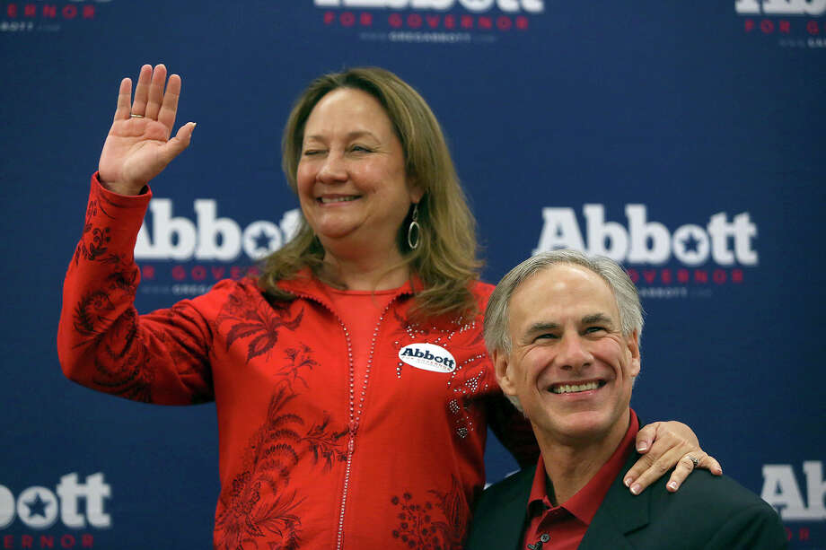 Texas Attorney General Greg Abbott and his wife, Cecilia Abbott, acknowledge the applause of their supporters after Abbott officially filed paperwork for his candidacy for governor of Texas at the Texas Republican Party headquarters in Austin on Saturday, November 9, 2013. Photo: Lisa Krantz, San Antonio Express-News / San Antonio Express-News
