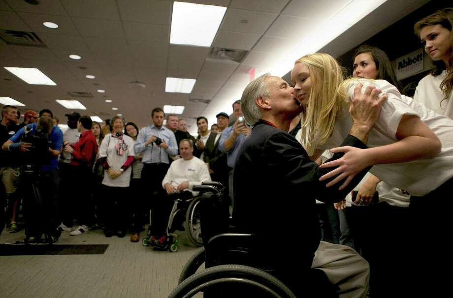 On Saturday, Nov. 9, 2013, Texas Attorney General Greg Abbott kissed his daughter, Audrey Abbott, after formally registering his candidacy for the Republican party's nomination for governor in next year's primaries. Abbott filed at the Texas Republican Party headquarters in Austin, Texas. Photo: Reshma Kirpalani, Austin American-Statesman / Austin American-Statesman