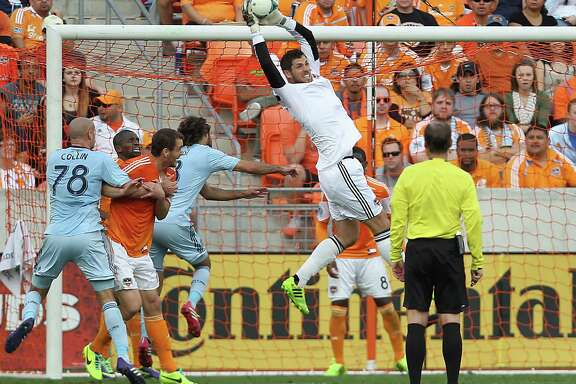 Dynamo keeper Tally Hall pulls down a cross to avert a scoring chance for Sporting Kansas City during Saturday's Eastern Confernce final match. Hall made two saves for his fifth career playoff shutout.