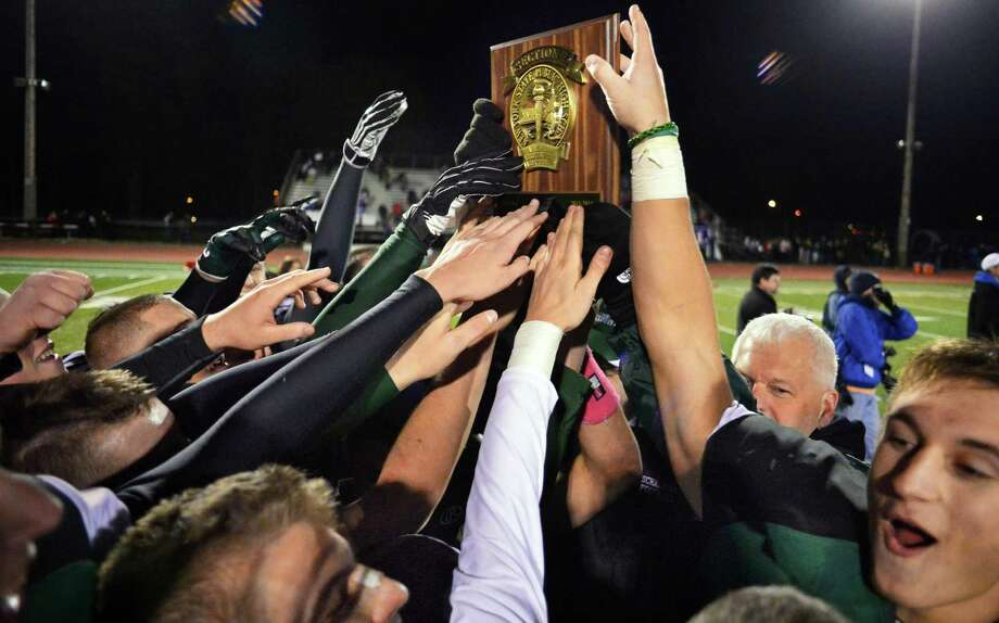 Schalmont players celebrate their Class B Super Bowl win against  Broadalbin-Perth at Shenendehowa High School Saturday Nov. 9, 2013, in Clifton Park, NY.  (John Carl D'Annibale / Times Union) Photo: John Carl D'Annibale / 00024546A