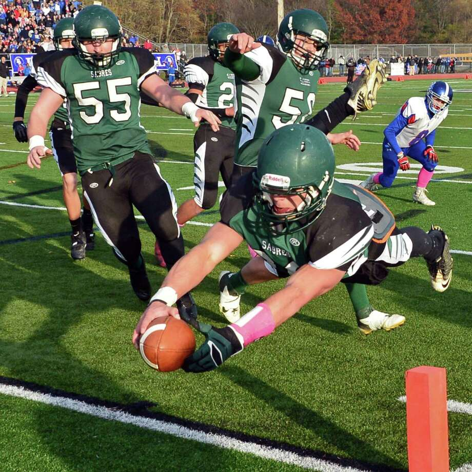 Schalmont's QB #36 Nick Gallo dives over the goal line to score his first touchdown against  Broadalbin-Perth in the Class B Super Bowl at Shenendehowa High School Saturday Nov. 9, 2013, in Clifton Park, NY.  (John Carl D'Annibale / Times Union) Photo: John Carl D'Annibale / 00024546A