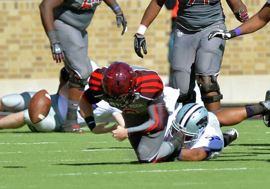 A sloppy game by Texas Tech quarterbacks included a fumble by Baker Mayfield forced by Kansas State's Blake Slaughter, a senior from Elkins. Photo: John Weast, Stringer / 2013 Getty Images
