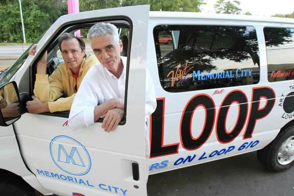 The Art Guys, Jack Massing and Michael Galbreth, are circling Houston's Loop 610 in a special van.