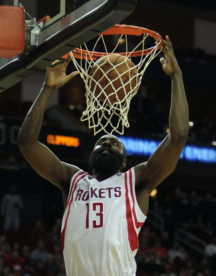 Rockets shooting guard James Harden dunks the ball against the Clippers. Photo: James Nielsen, Houston Chronicle