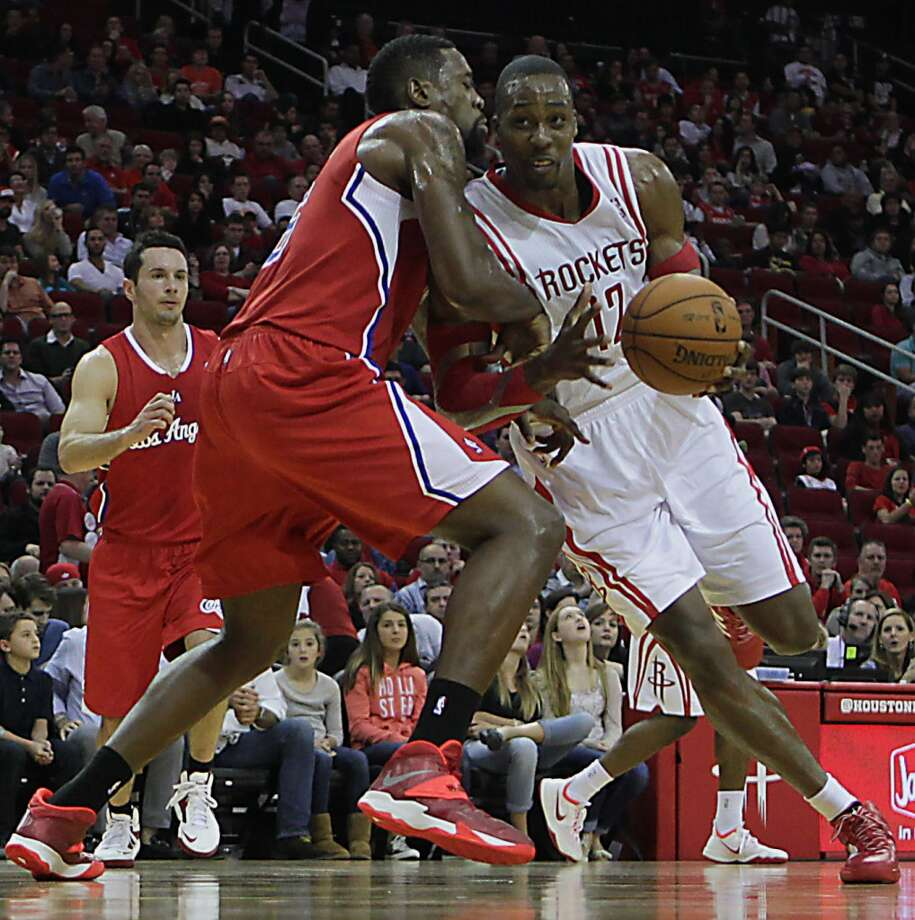 Clippers center DeAndre Jordan and Rockets center Dwight Howard. Photo: James Nielsen, Houston Chronicle