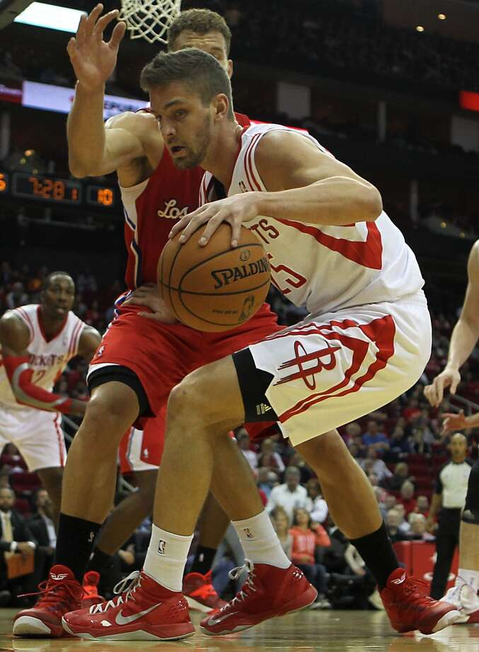 Rockets small forward Chandler Parsons breaks away from Clippers power forward Blake Griffin. Photo: James Nielsen, Houston Chronicle