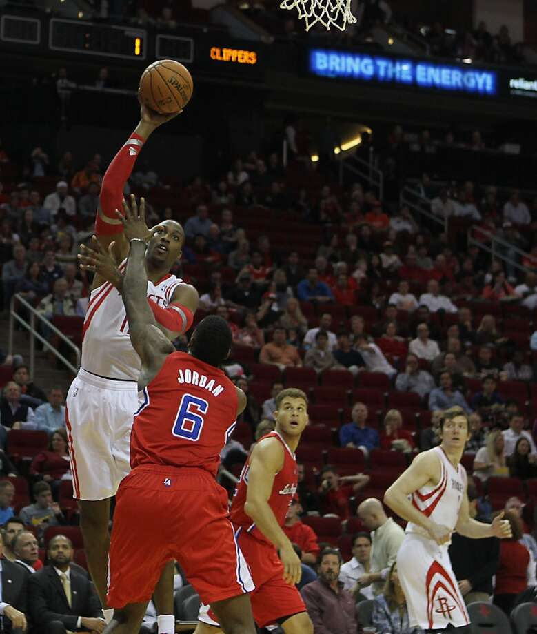Rockets center Dwight Howard left, shoots the ball over Clippers center DeAndre Jordan. Photo: James Nielsen, Houston Chronicle