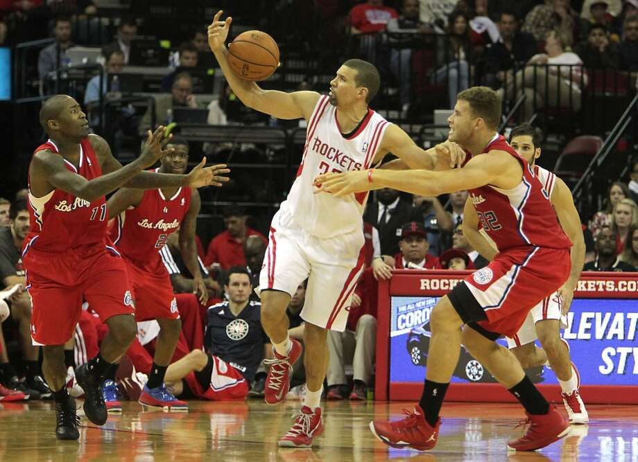 Rockets shooting guard Francisco Garcia center, pulls a loose ball away from Clippers shooting guard Jamal Crawford left, and Clippers power forward Blake Griffin. Photo: James Nielsen, Houston Chronicle