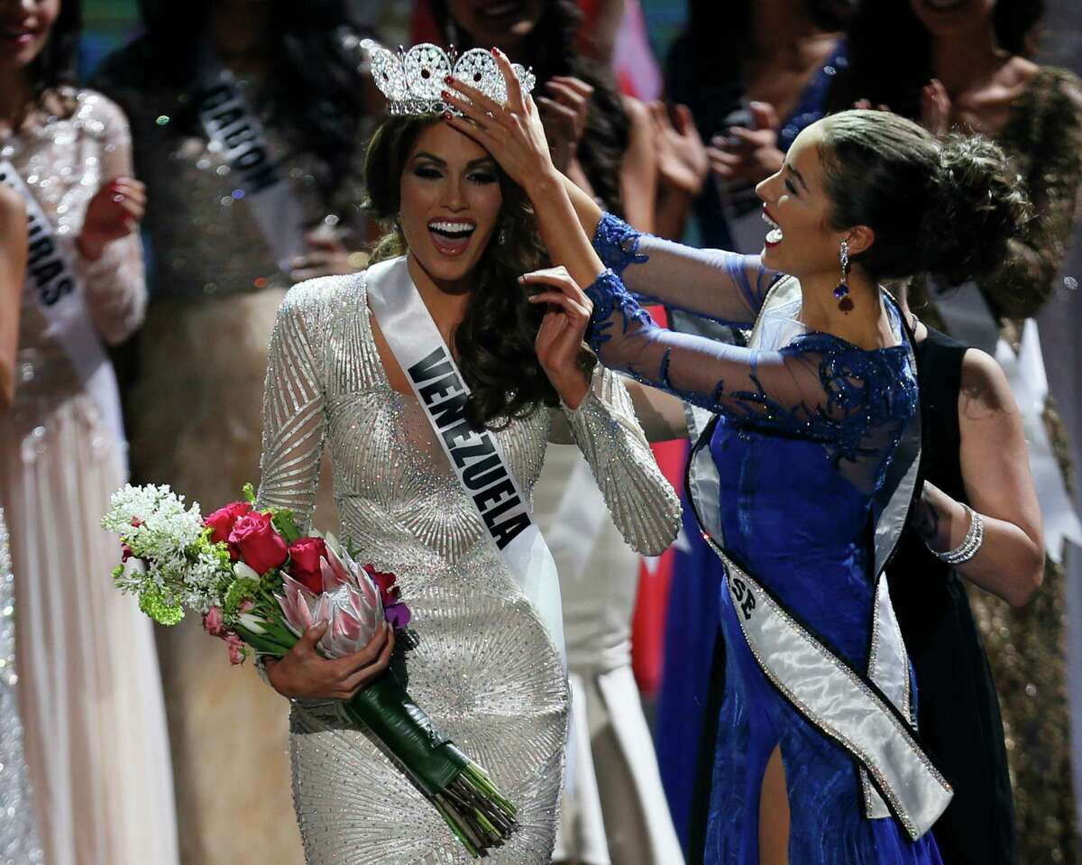 Miss Universe 2012 Olivia Culpo, from the United States, right, places the crown on Miss Venezuela Gabriela Isler during the 2013 Miss Universe pageant in Moscow, Russia, on Saturday, Nov. 9, 2013.