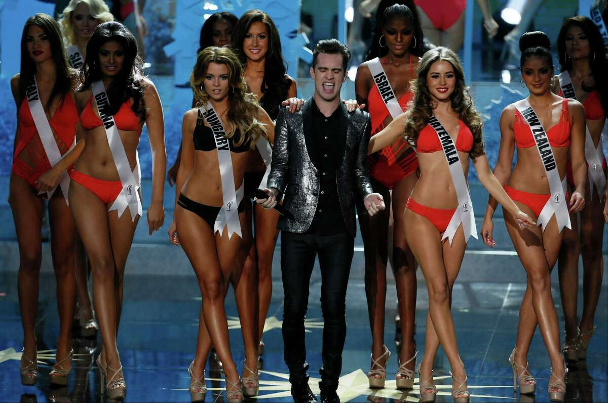 Brendon Urie from Panic at the Disco, center, performs at the 2013 Miss Universe pageant in Moscow, Russia, on Saturday, Nov. 9, 2013.