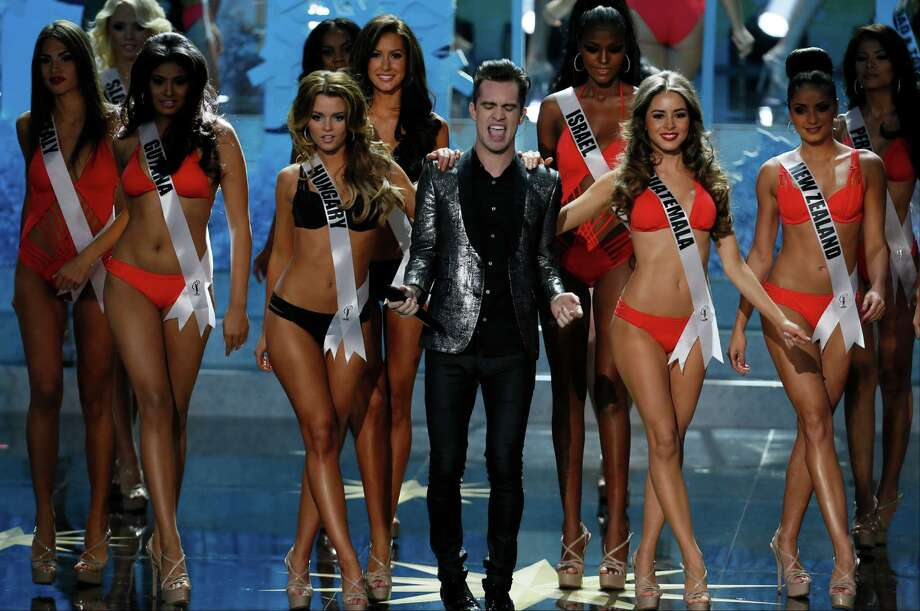 Brendon Urie from Panic at the Disco, center, performs at the 2013 Miss Universe pageant in Moscow, Russia, on Saturday, Nov. 9, 2013. Photo: Pavel Golovkin, AP / AP