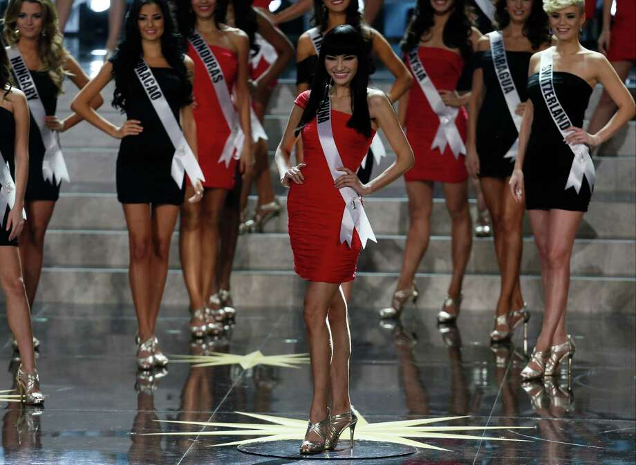 Miss China Jin Ye, center, participates in the 2013 Miss Universe pageant in Moscow, Russia, on Saturday, Nov. 9, 2013. Photo: Pavel Golovkin, AP / AP
