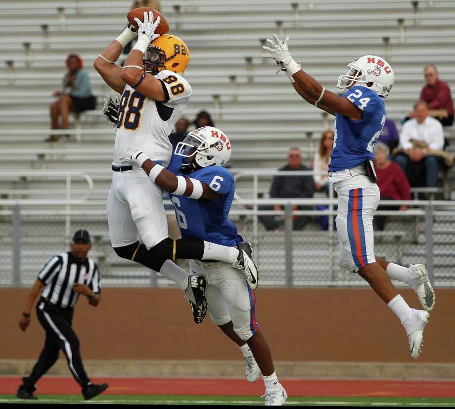 HBU's Ja'Halen Norris (6) and Taylor Thompson (24) can't prevent a touchdown reception by Texas A&M-Commerce's Hayden Marsh during the first half Saturday. Photo: Eric Christian Smith, Freelance